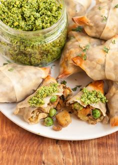 Samosas were my gateway into Indian food back in my college days. What's not to love, really? They're crispy handheld puffs stuffed with spicy potatoes, peas, and onions — a plate of them is an appetizer to share with friends, two or three of them make an excellent lunch to eat on the way to class. I've recently become obsessed with making an easy, baked version of these traditional, potato-filled samosas at home.