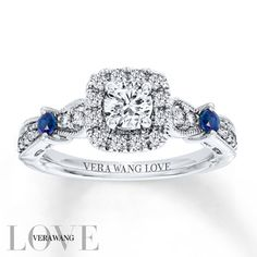 From the Vera Wang LOVE Collection, this eye-catching engagement ring features a 3/8 carat round center diamond framed by accent diamonds. The ring's diamond-lined band features two round sapphires that add color and sparkle, a signature of the collection and a symbol of faithfulness and everlasting love. Intricate milgrain detailing completes the exquisite design. Set in 14K white gold with 3/4 carat total weight of diamonds, the engagement ring is a brilliant beginning to your romantic…
