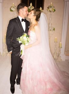 In October 2012, actress Jessica Biel wed singer Justin Timberlake in this beautiful pale pink wedding gown. It was custom made by Giambattista Valli Haute Couture as seen in this picture from their PEOPLE magazine photo shoot. #pinkweddings #celebrityweddings #jessicabiel #hautecouture #pinkgown