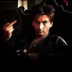 Animated gif from Fright Night of David Tennant wearing leather and raising his middle finger
