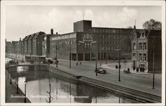 1942. View on the Amsterdam Police Headquarter at the Elandsgracht between the Marnixstraat and Singelgracht. The construction of the building started in 1937, but the completion of the building was delayed till 1941 due to Worldwar II. Photo Timmermans & Co. / HEMO. #amsterdam #1942 #elandsgracht