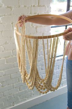 Check It Out! 30 Elegant How to Make A Beaded Chandelier - Diy Bead Chandelier the House that Lars Built. See Also Vintage Metal Wood Chandelier Zulily Light Beautiful Light. Diy Luz, Pottery Barn Hacks, Wood Bead Chandelier, Chandelier Lighting, Chandeliers, Boho Lighting, Shell Chandelier, Outdoor Chandelier, Pendant Lamps