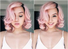Pastel pink hair - seems girly and feminine at first glance, but the darker roots give it a tougher edge.