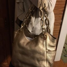 Michael Kors gold leather handbag Gold Michael Kors handbag- a little worn Michael Kors Bags Satchels