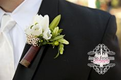 Groom's boutonniere with white flowers in shotgun shell.  Classic fall wedding.  Photography by Andie Freeman Photography www.TheAthensWeddingPhotographer.com Planning and Coordinating by Wildflower Event Services www.WildflowerEventServices.com Venue and Floral:  The Thompson House and Gardens, Athens, GA