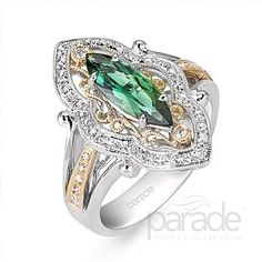 A vintage inspired two-tone ring complete with milgrain detail and a rich green tourmaline. Parade Designs - Parade In Color  - Style: R2345/M1-WYFS