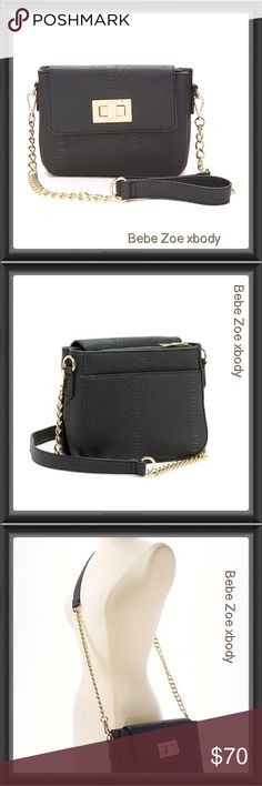 """BEBE ZOE BLACK W/GOLD DETAIL TURN-LOCK CHAIN XBody PRODUCT DESCRIPTION: Enhance your ensemble with this chic crossbody bag that boasts a posh chain handle and flash of gold hardware.  Detachable crossbody strap Imported - Removable chain shoulder strap - Foldover flap with turn lock closure - Exterior features 1 open compartment with snap button closure and 1 zip compartment with 1 zip wall pocket and 2 open pockets. Embossed.  - Approx. 12"""" L x 8"""" H x 4"""" W  - Approx. 24"""" strap drop, 48"""" max…"""