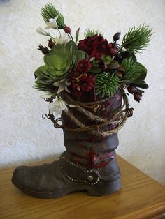 My creation... western boot with succulent and rose arrangement