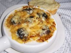 A special recipe for Escargots Bouguigon fans. These are the best escargots.(snails) I found this recipe in a Quebec site and it changes the rubbery texture you get with canned escargots. Chose the smaller escagots(36-40)..much better. This is an appetizer for for 4 or a main course for 2.Add a chopped shallot and parsley to the buttter