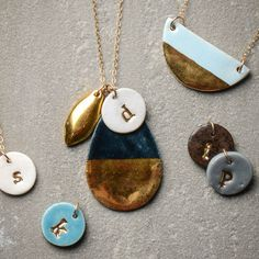 Top stocking stuffer ideas! Charming jewelry-A simple accessory with a personal touch, our sweet Susan Gordon clay initial charms make for the ideal accent for every look. Handmade and delicate, these original pieces are perfect for the effortless gift giver who loves to leave an impression.