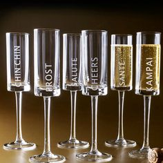 These celebration glasses from Nieman Marcus are etched in several languages.  A DIY version could be made using stencils.