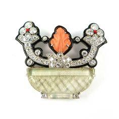 - Art Deco diamond, mother-of-pearl, corallium rubrum and enamel basket of flowers brooch by Cartier, c.1925
