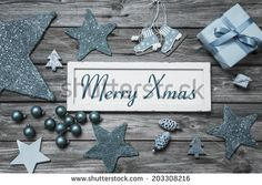 Merry Xmas greeting card with white wooden sign and blue turquoise decoration. - stock photo