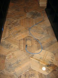 Probably the best floor ever! Reclaimed Hex Wine Barrel End Flooring by Whit McLeod Furniture