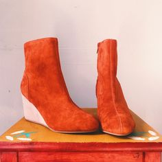 vibrant orange Ruth wedge heel *material is a vibrant orange suede *never worn *size 6, will fit a 6.5 too *comfortable 2 inch heel Urban Outfitters Shoes Ankle Boots & Booties
