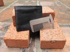 Wallet Self Defense Comb The first wallet card protection tool you can use without removing from your wallet. Can be used as a Comb, Saw for cutting wood, and Rope Tightener.