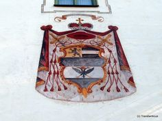 The colourful emblem of Prince-Archbishop of Salzburg Hieronymus von Colloredo seen at a building in the Styrian market town Haus. Hieronymus von Colloredo (Wikipedia) Disclosure: This trip was supported by Hotels Österreich and Panoramahotel Gürtl Germany And Italy, Coat Of Arms, Architecture Details, Austria, Sundial, House, Family Crest