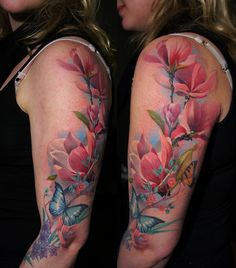 Magnolia sleeve tattoo with a butterfly. The tattoo is inked in realistic and feminine style, a perfect sleeve tattoo for women.