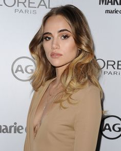 Suki Waterhouse upgraded her signature shade of golden blonde with the grown-out cool of a few inches of dark roots
