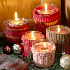 Repurpose old sweaters or wool socks as candle cozies. Cut sleeves or socks to slip over glass candleholders and hem the edges to prevent fraying. Make the cozies a little bit shorter than the candleholder, to prevent the material from getting too close to the candle flame.