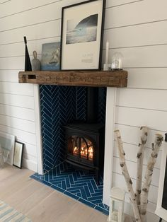 Blue Fire Clay tile in a chevron pattern in a stove fireplace with railway sleeper mantle Fireplace Hearth Tiles, Home Fireplace, Fireplace Remodel, Fireplace Design, Fireplace Surrounds, Fireplaces, Log Burner Living Room, Home Living Room, House