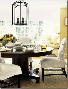 White linen slipcovers and sea-grass wallpaper are a winning combination ... Add a lantern and you have a fabulous look.