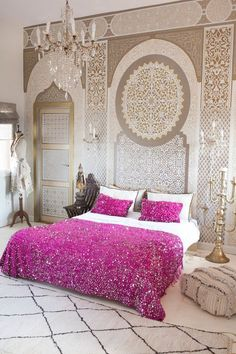 stencilled walls in Moroccan style coloured with a pink quilt cover. Beautiful neutral interior design.