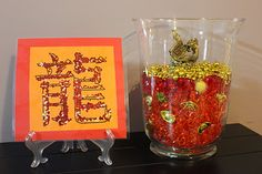 Use glitter to decorate the Chinese character for dragon, then laminate.