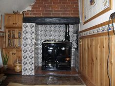 Rayburn Cooker in inglenook fireplace