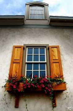 Would love to add shutters and window boxes like this to my house... Makes it look so homey!