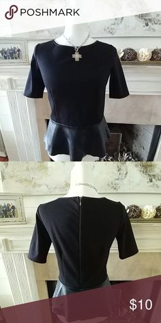 Willi Smith Peplum Top Black with faux leather peplum. The back zips down for easy removal. It looks great with skinny jeans & heels or pencil skirt. You can wear with anything but I always dressed it up. Worn but in very good condition. Willi Smith Tops Blouses
