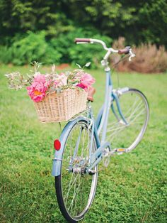 Blue bicycle with a basket of flowers | Photo by Mollie Crutcher