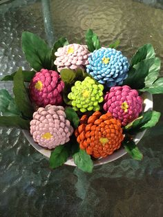Acrylic painted pine cones look like zinnias .