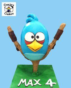 Angry Bird on slingshot gravity defying cake.