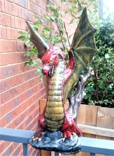 Check out this item in my Etsy shop https://www.etsy.com/au/listing/491654904/dragon-statue-hand-painted-ceramic
