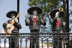 Papier-mache skeleton figures dressed as musicians for the traditional Day of the Dead festivities in Mexico.