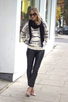 The jumper is from IRO, the pants Sara Berman, a scarf from Zara, shoes from Kurt Geiger, sunglasses Prada, and watch IWC
