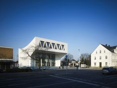 Built by Wulf Architekten in Hamm, Germany The initially square building from the 1970s with its typical anonymous façades and platform roof was expanded and le...