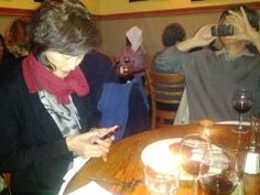 Dad taking a photo of Mom taking a photo of her food. now I know why I'm such a foodie