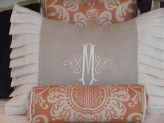 Master bedroom pillows but on a larger scale. Monogram pillow in ivory w monogram in darker shade of blue/gray, roll pillow in the base color of your oushak rug.