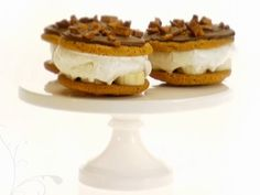 Food Network invites you to try this Frozen Banana Ice Cream Sandwiches recipe from Giada De Laurentiis.