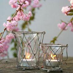 Hanging glass & wire lanterns by  ella james