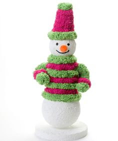 Mr. Doodle Snowman - This merry snowman will greet your visitors all through the holiday season! Using thick bulky Doodle™ yarn makes it easy to cover the Styrofoam™ cone base and create this jolly decoration.