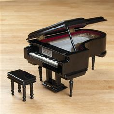 Your own private piano recital, with just the simple winding of a key! This grand piano plays Beethoven's famous bagatelle 'Fur Elise'. Beautifully crafted of solid, high-gloss wood and comes with a tiny matching piano bench. Piano Crafts, Piano Lessons For Beginners, Piano Recital, Baby Grand Pianos, Piano Bench, Music Stand, Find Music, Up Music, Music Decor
