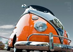 Awesome shot of this sweet black and orange VW Bus.
