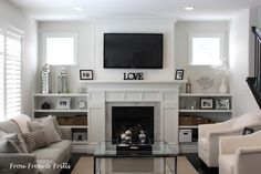 bookshelves that look like built ins surrounding a fireplace | Make Your Fireplace Built-Ins Functional