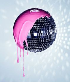 I think this is so funky and cool. I love the sparkle that the disco ball as, and the design it leaves on the wall. The hot pink paint adds such a cool pop of color. I love how it drips off the side and shows the contrast between the bubble gum pink and t Pink Lady, The Wicked The Divine, Catty Noir, Mirror Ball, Couleur Fuchsia, Look Vintage, Looks Cool, Pink Aesthetic, Steam Punk