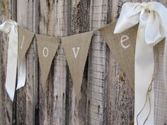 burlap + white paint, with the letters of their names instead?