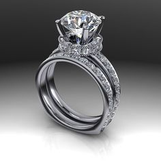 A Beautiful and unique euro shank bridal set shown with a 3 CT Round Forever One Colorless Moissanite and accented with 63 diamonds of G/H SI1 quality, 1.91 ct. The newest stone in the moissanite fami