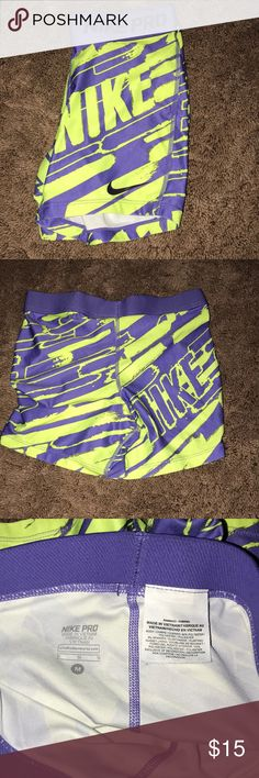 Green and purple Nike pros Green and purple nike design, worn but in good condition ! any questions, please comment !!:) •Same or next day shipping!!• Nike Shorts